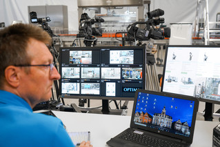 A video technician monitors the live streaming